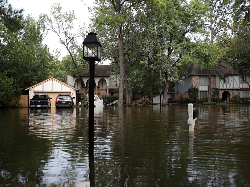 Large houses on a flooded street