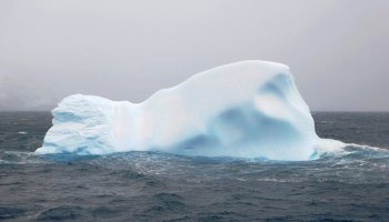 An iceberg floats in the Southern Ocean.