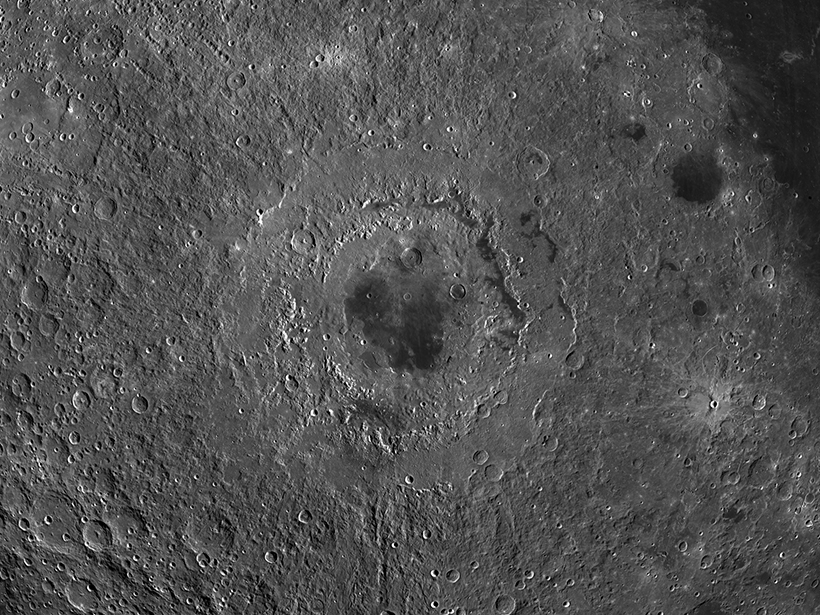 Image of the cratered lunar surface, centered on Mare Orientale, a multiringed crater that resembles a bull's-eye