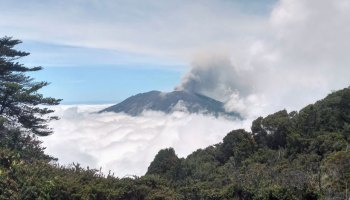 Image of Turrialba volcano summit surrounded by clouds