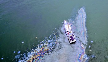 Aerial photo of a ship in an oil slick