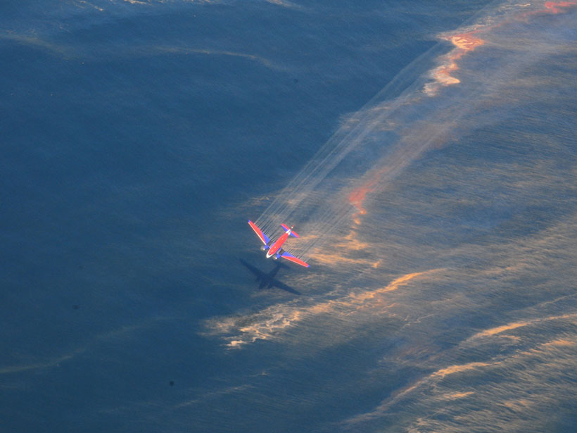 An aircraft releases chemical dispersant on 5 May 2010 over oil floating on the surface of the Gulf of Mexico