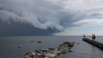 Huge cumulonimbus clouds advance on jetties in the Baltic Sea
