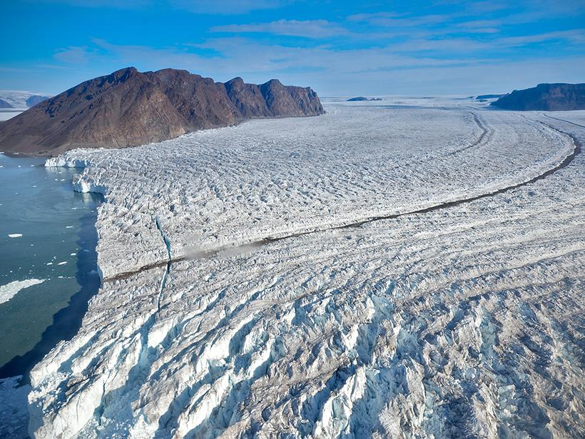 Aerial view of an enormous tidewater glacier, Bowdoin Glacier, in Greenland