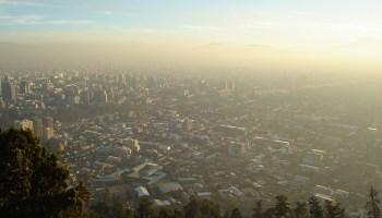 Smog hovers over a city skyline.