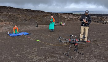 Scientists test a drone atop Mount Kīlauea in Hawaii.
