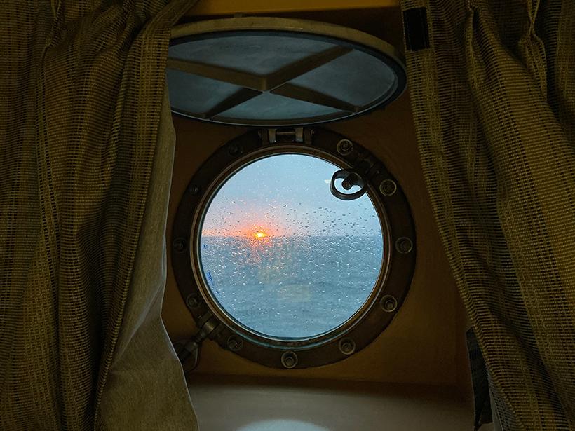 Sunset through a ship window on the R/V Sikuliaq