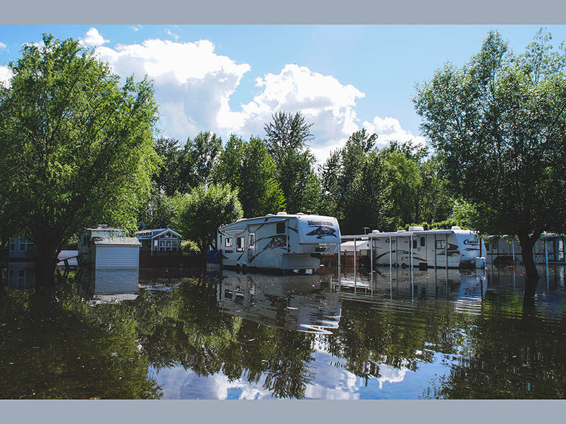 Motor homes stand amid floodwater