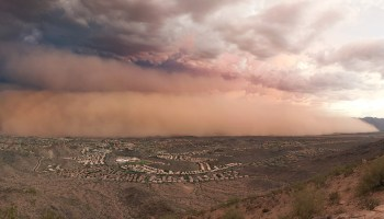 A dust storm approaches the outskirts of Phoenix in 2011.