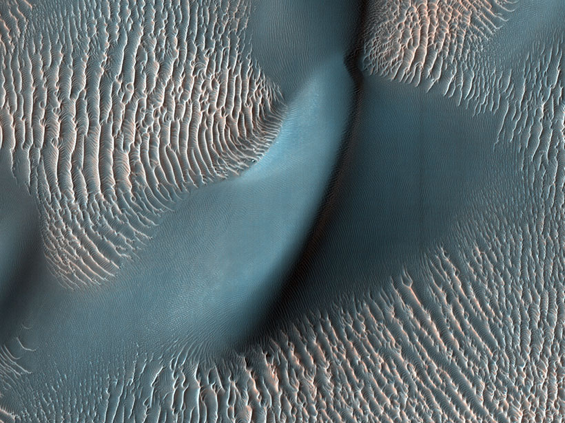 An image depicting bright-toned sand ripples in Proctor Crater on Mars.