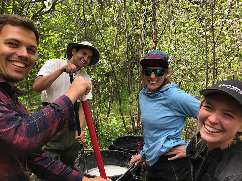 Stefan Klingler, Ian Gambill, Jackie Randell, Anna Marshall mix salt into water for an in-stream tracer test in Little Beaver Creek in northern Colorado.