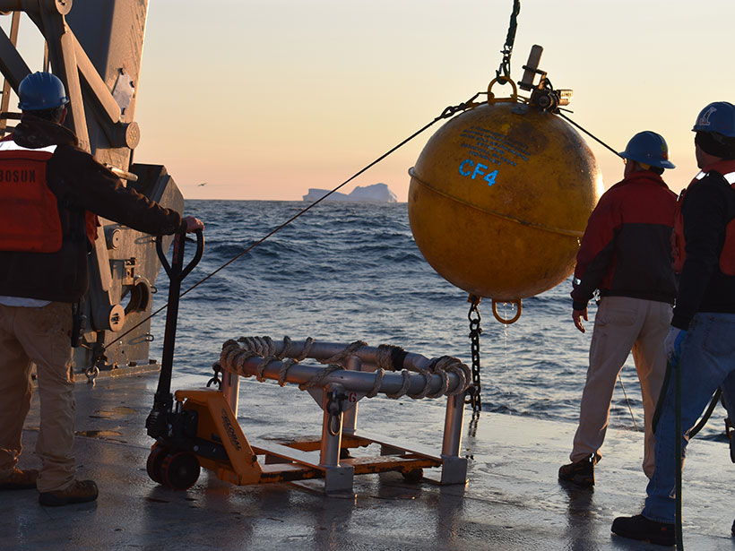 A ship's crew recovers the flotation sphere for an instrument mooring in the Irminger Sea