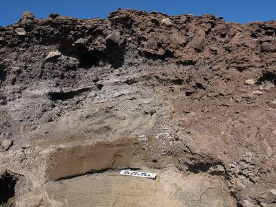 Cross sectional view of rock and soil deposits left by a past volcanic eruption