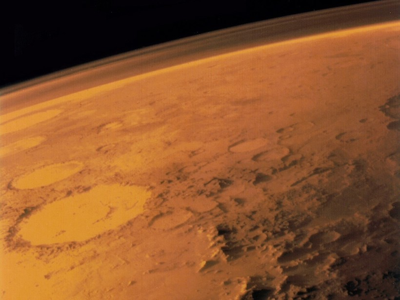 Image of part of Mars showing the planet's atmosphere on the horizon