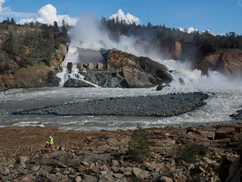 Water rushing down the damaged Oroville dam spillway into the river.