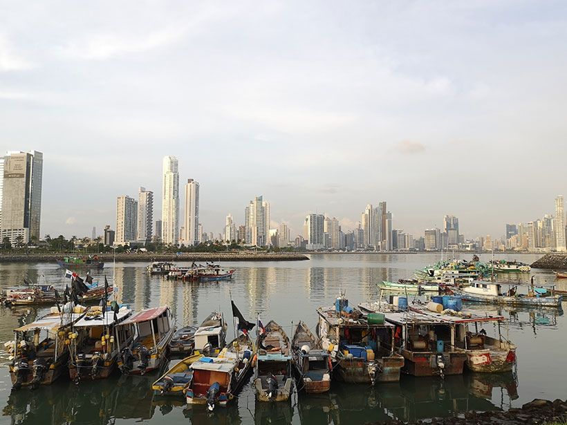 The skyline of Panama City, Panama, with fishing boats in the foreground