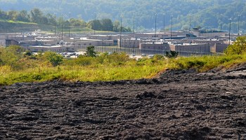 A coal ash dump in the foreground with SCI in the background