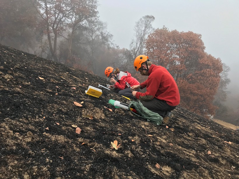 A USGS research team from the Geology, Minerals, Energy, and Geophysics Science Center takes measurements of hydrologic properties of burned and unburned soils in the LNU Lightning Complex Fire area in Napa County, Calif., in early October.