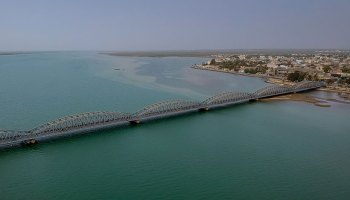 Aerial photo of Saint-Louis, Senegal, with the Faidherbe Bridge connecting the newer part of the city with the African mainland