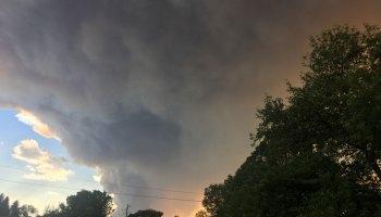 Huge plumes of smoke billow behind rural homes in Brian Head, Utah, in 2017.
