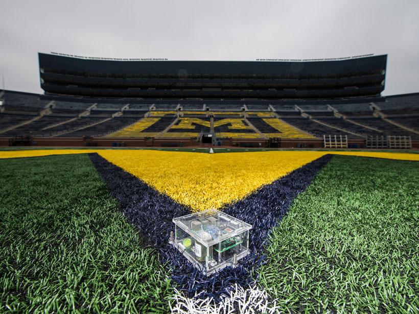 A Raspberry Shake seismograph on an empty University of Michigan field