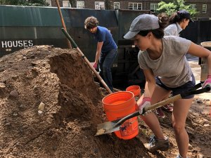 Yolanda Gonzalez helps unload soil as part of the NYC Clean Soil Bank