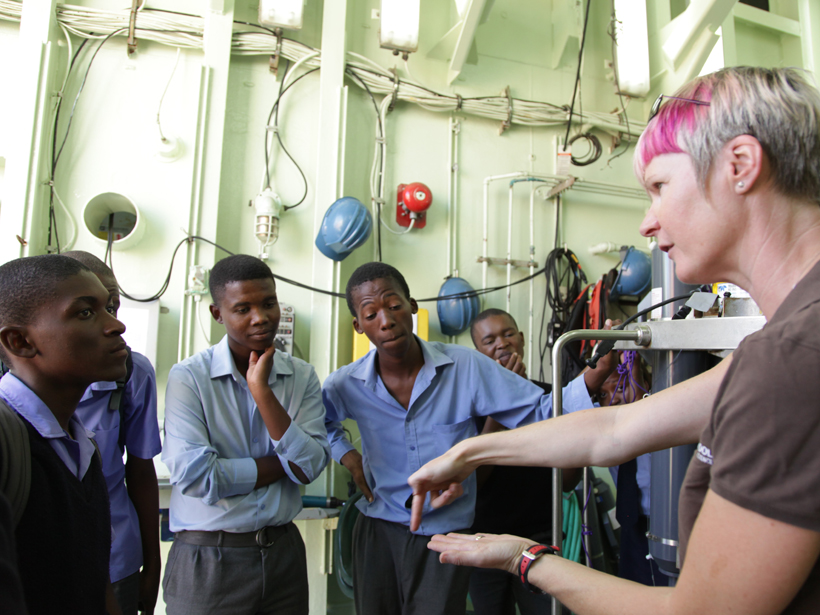 Photograph of Lisa Beal giving a tour aboard RV Knorr