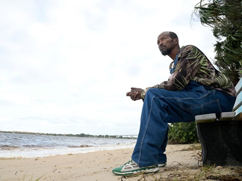 Gerald Newberry sits on a bench at the waterfront next to the Port of Fort Pierce, Fla.