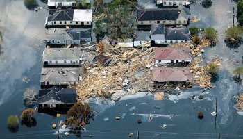 New Orleans, La., houses surrounded by debris and floodwater from Hurricane Katrina in 2005.