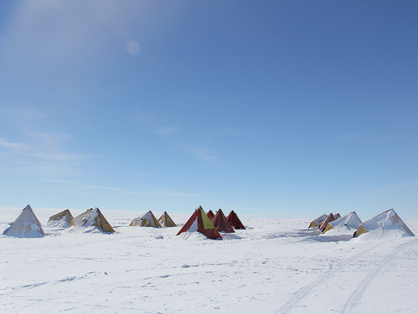 Tents set up on a snow and ice field in Aurora Basin North, East Antarctica