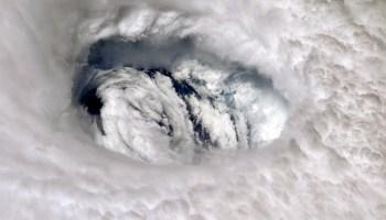 A close-up photograph of the eye of Hurricane Dorian.