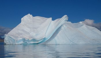 An iceberg floats off of Baffin Island in the North Atlantic Ocean.