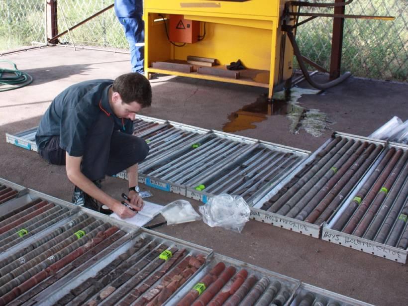 a researcher sampling Precambrian drill core in South Africa
