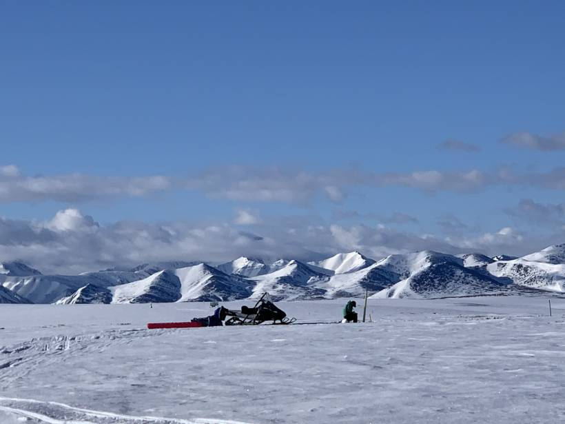 A student takes notes in Arctic Alaska.