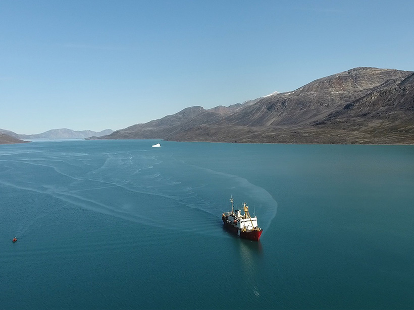 The research vessel CCGS Hudson in Southwind Fjord, Baffin Island, with the iceberg that initiated a submarine landslide in the background.