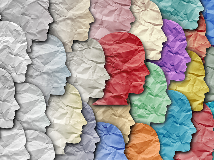 An illustration of many paper silhouettes changing from white on the left to a variety of colors on the right