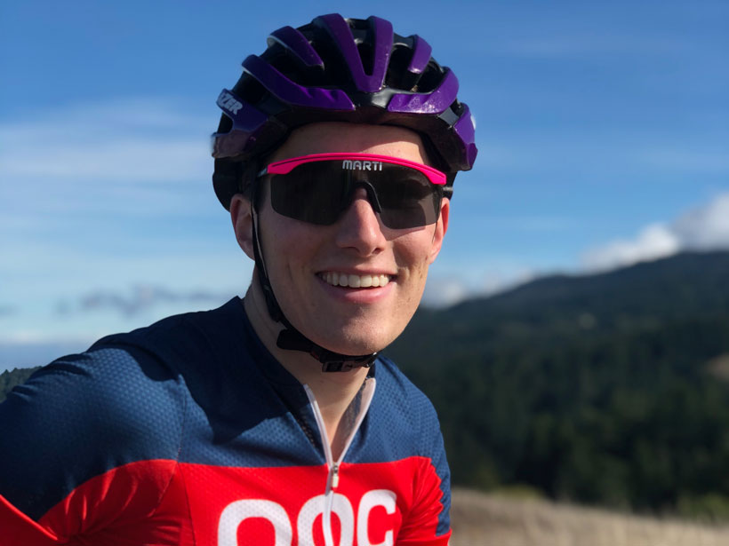 Cooper Elsworth smiles from a bicycle.