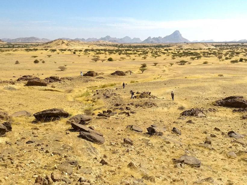 Expansive flat landscape marked by large flat stones.
