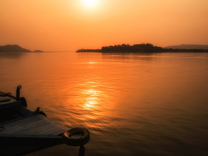View of the Brahmaputra River with the sun low on the horizon