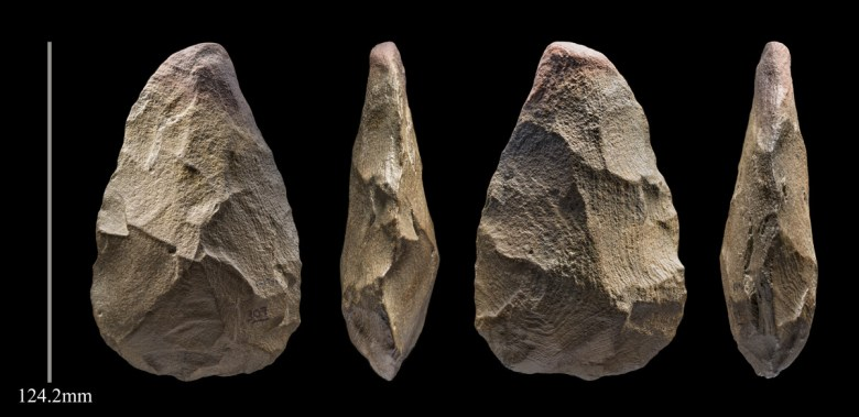 A 400,000-year-old hand axe, seen from all four sides, with a measurement bar of 124.2 millimeters