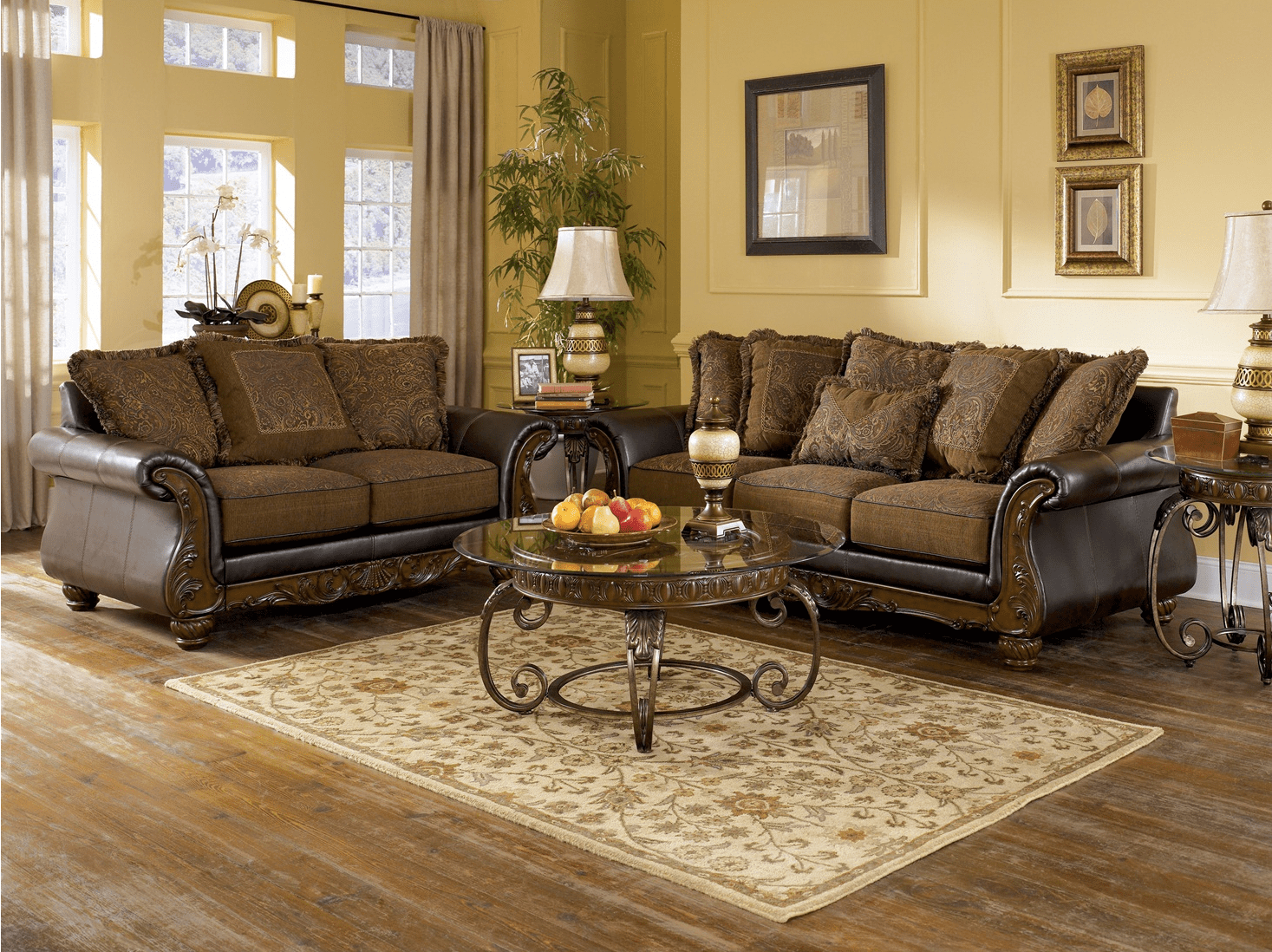 The possibilities are endless when you use white as the base of your color palette for your living room furniture. Wilmington Traditional Living Room Furniture Set by Ashley