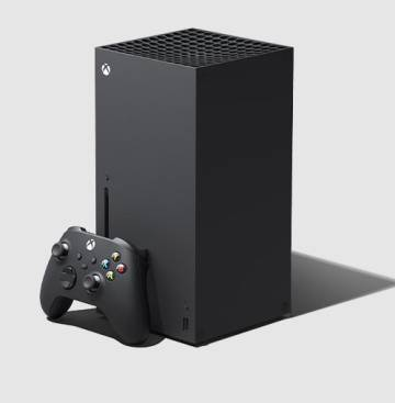 The Xbox Sweries X, next to its controller.