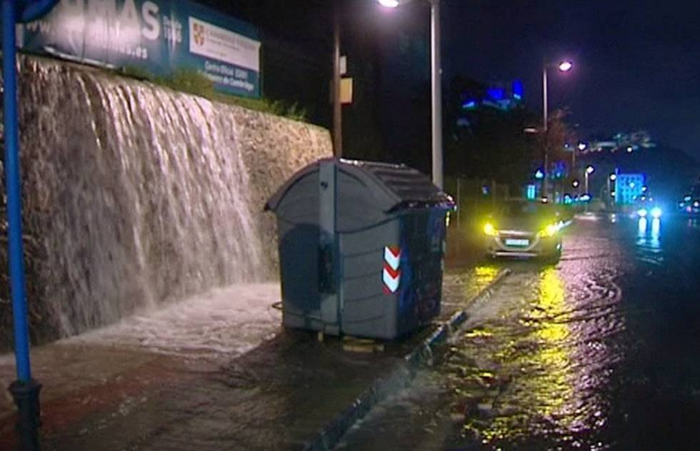 Water pouring down into a street in Alicante.