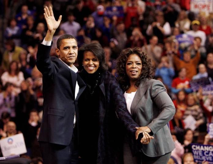 Los Obama, con Oprah Winfrey, en diciembre de 2007