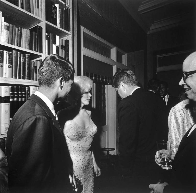 Marilyn Monroe with Robert and John Fitzgerald Kennedy after singing John 'Happy Birthday, Mr. President' on May 19, 1962 at Madison Square Garden in New York.