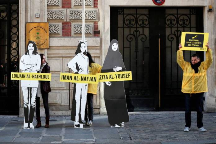 Amnesty International activists protest against arrests of Saudi feminists in March before the Saudi Arabian Embassy in Paris.