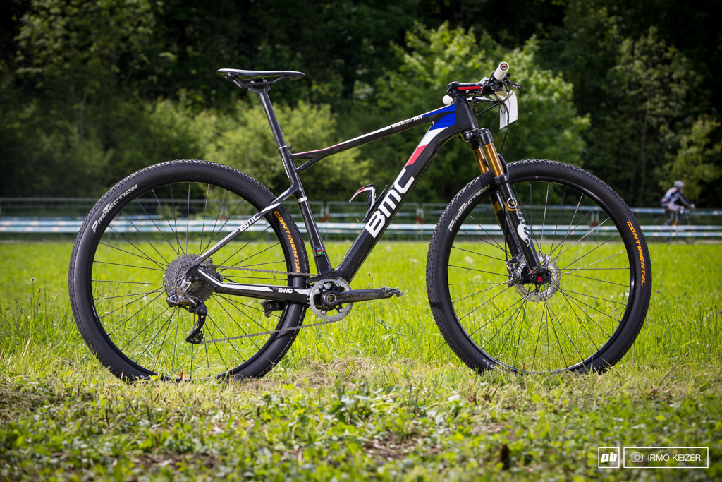 Julien Absalon s BMC. Absalon choses to ride a single chainring 11-40 Shimano Di2 setup this weekend. A custom made carbon chain guard adds extra security.