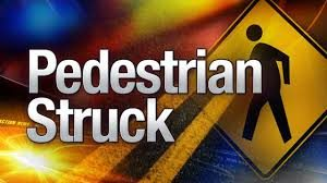 Female struck while riding electric cart