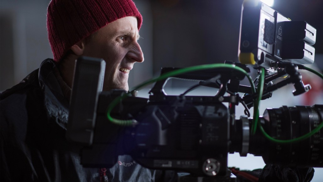A Video director looking at the camera screen