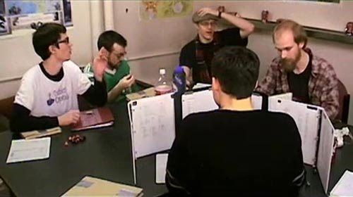Role-players sitting around a table from the movie The Gamers